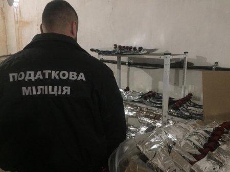 Податкова міліція Рівненщини ліквідувала підпільний цех з виготовлення фальсифікованого алкоголю